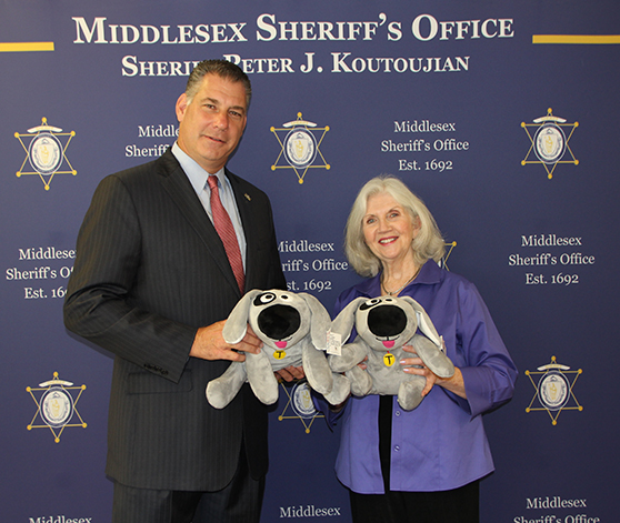 """Visiting a loved one in jail can be a difficult experience for a youngster. Thanks to the generous donation made by The Kennek Foundation, MSO staff was this week able to present a young girl with a Trouble the Dog, bringing them a measure of comfort during a difficult time."" Sheriff Peter J. Koutoujian, Middlesex Sheriff's Office"