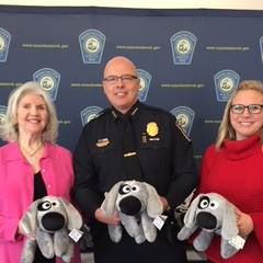 Manchester Police Chief Willard, The Kennek Foundation's Sheila Duncan, and HIllarie Scott of NH Speedway Children's Charities